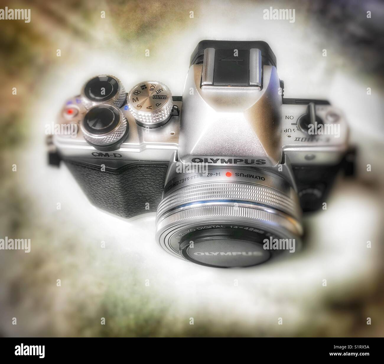 High angle view of an Olympus OM-D micro four thirds camera. - Stock Image