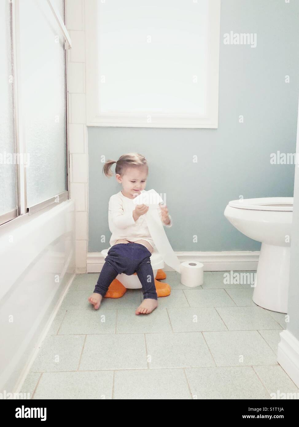 Mature man play on toilet