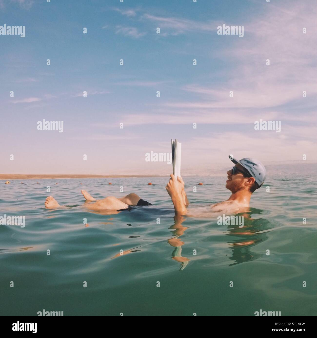 Floating in the Dead Sea Stock Photo