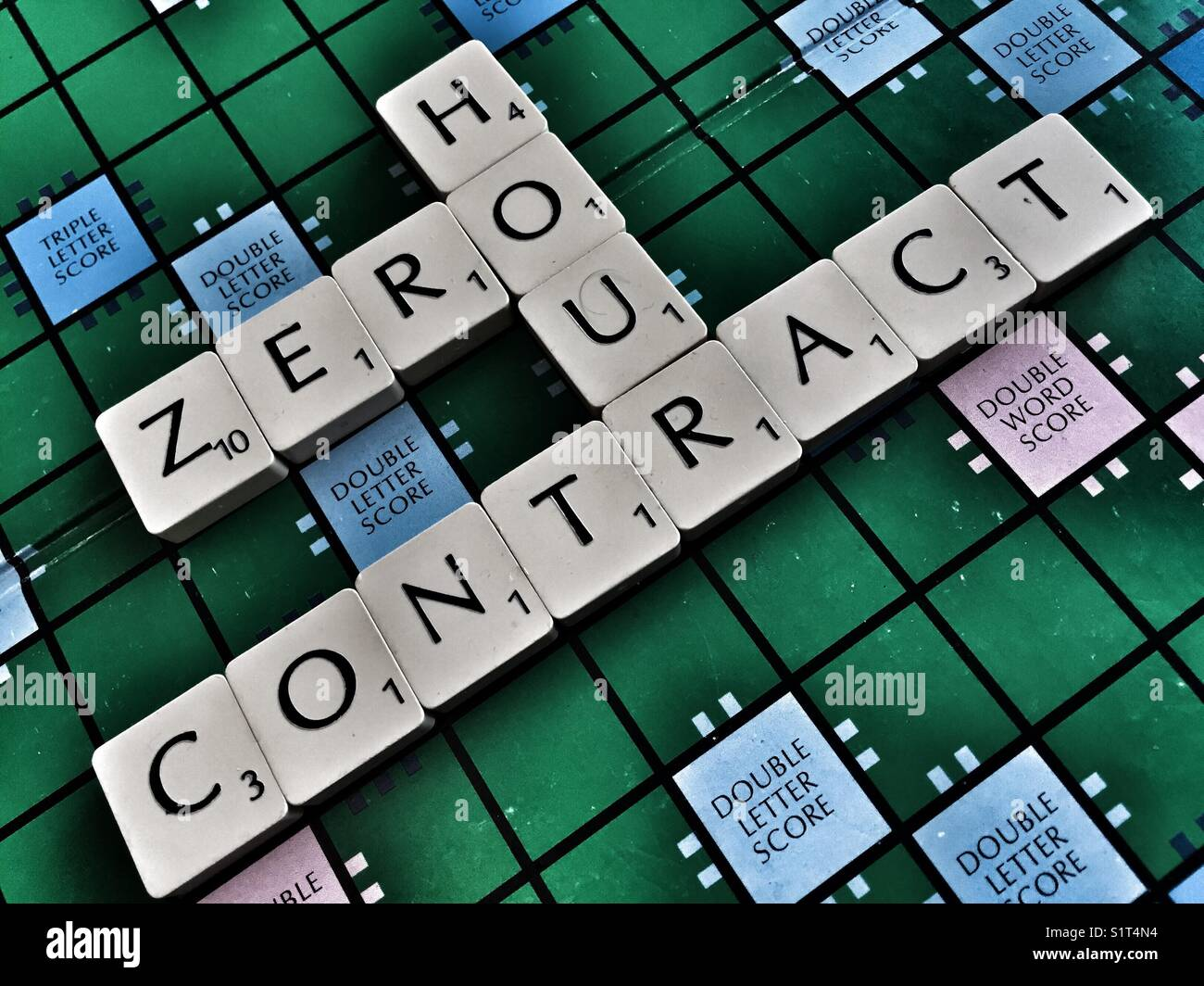 The words: Zero hour contact written with scrabble tiles - Stock Image