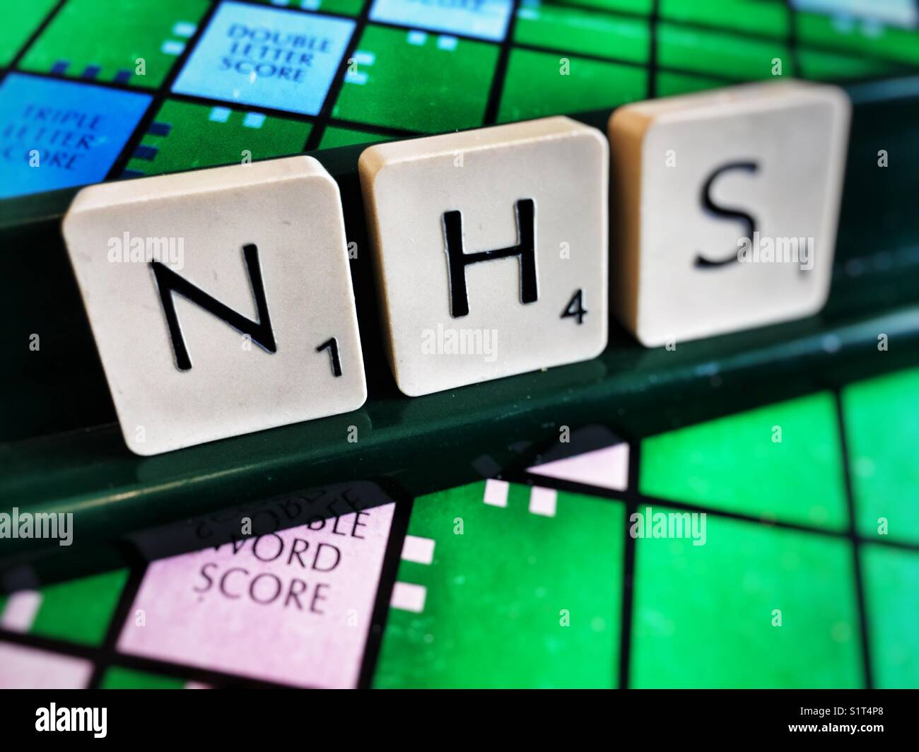 NHS (National Health Service) written with scrabble tiles Stock Photo