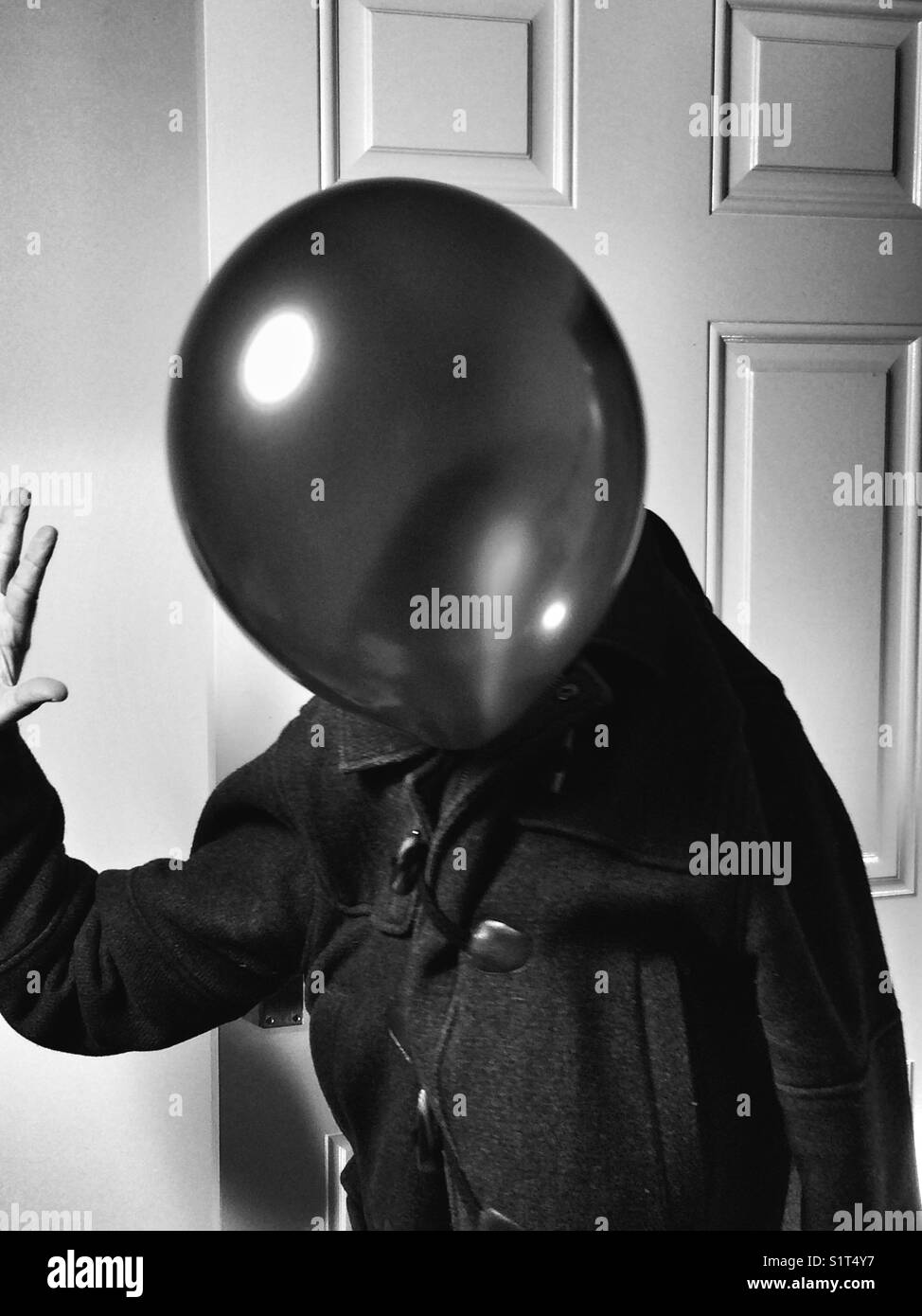 Mr blue/balloon walking and making a gesture. - Stock Image