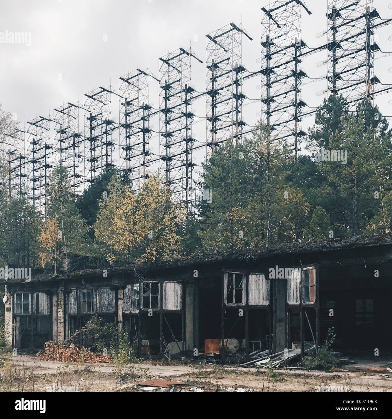 Derelict houses in fromt of the Duga-1 Radar installation in Stock ...