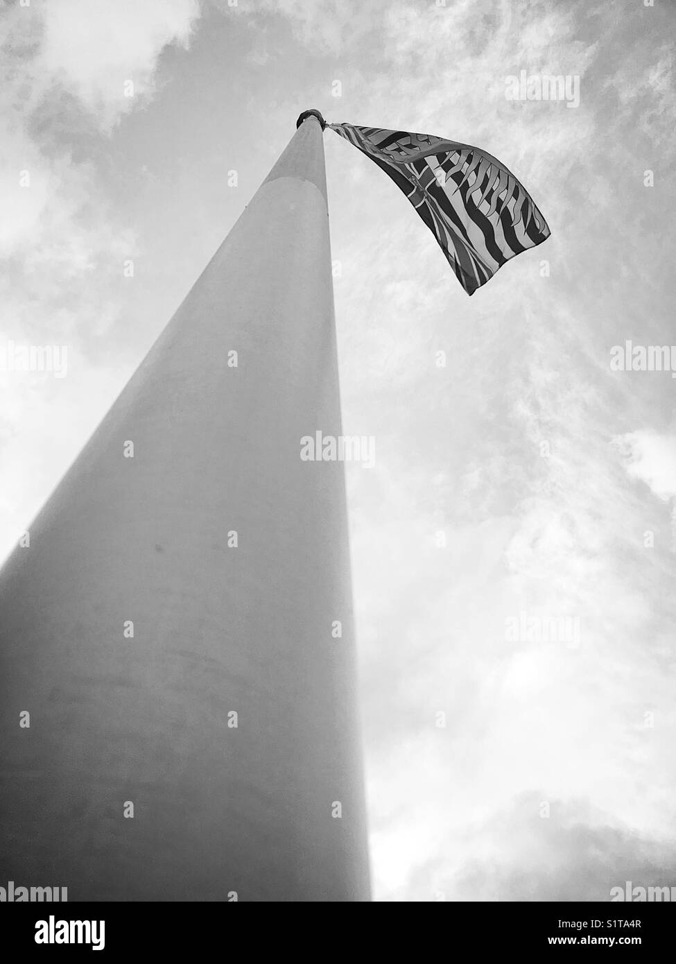 British Columbia, Canada's flag flying on flagpole. - Stock Image