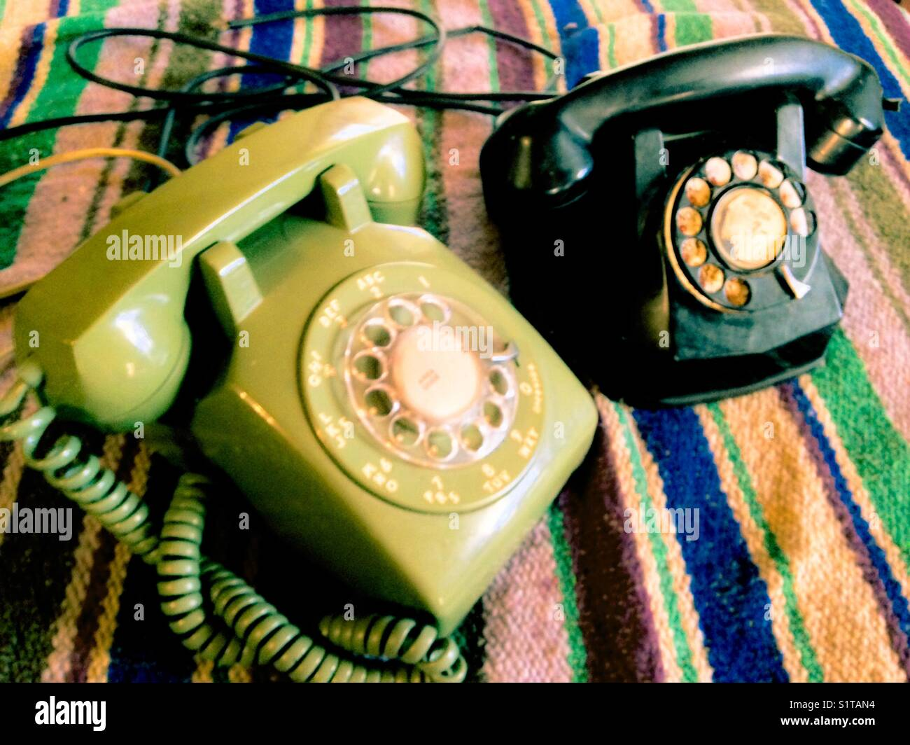 2 eras of vintage telephones - Stock Image