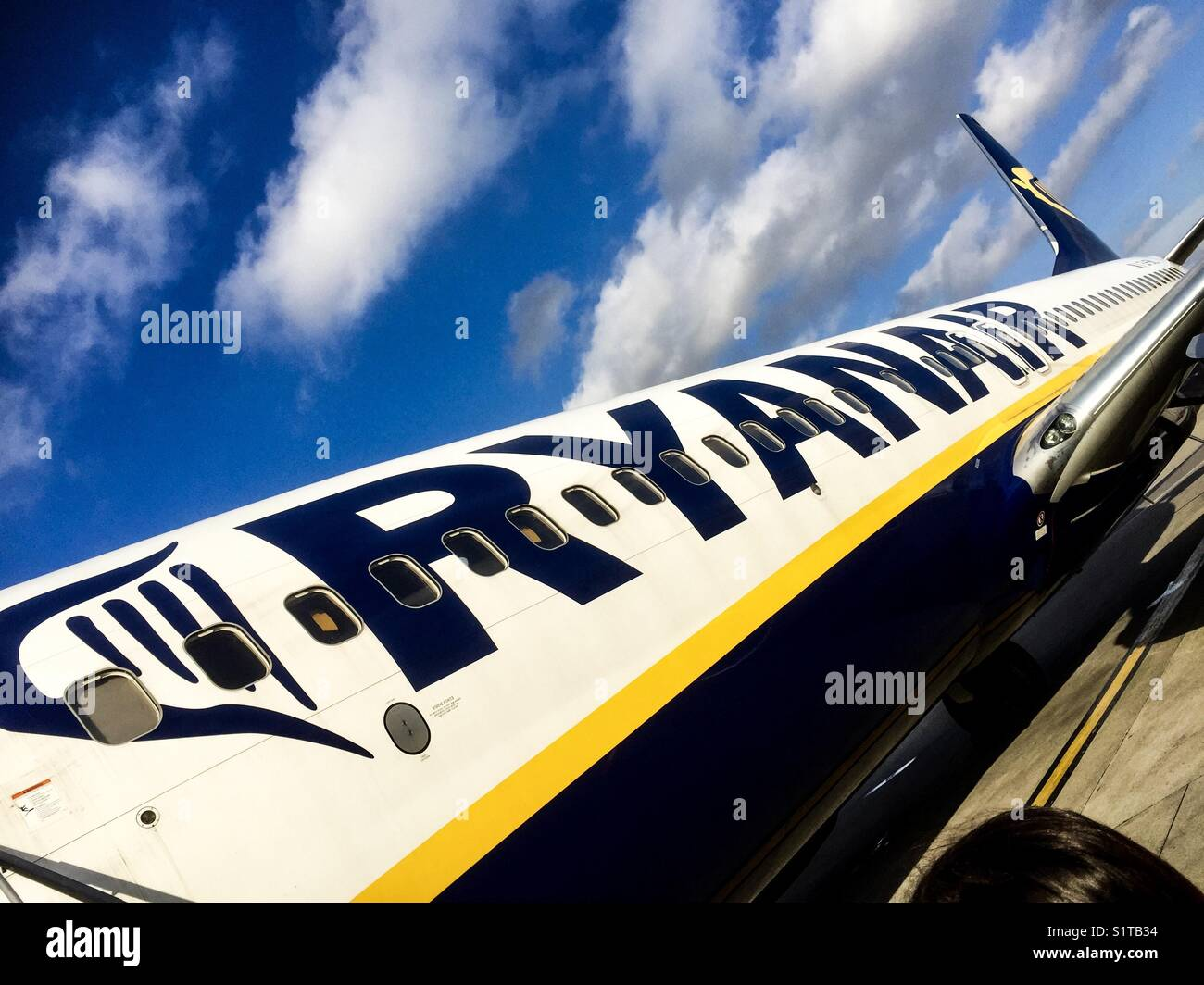 A Ryanair plane fuselage close up at an abstract angle - Stock Image