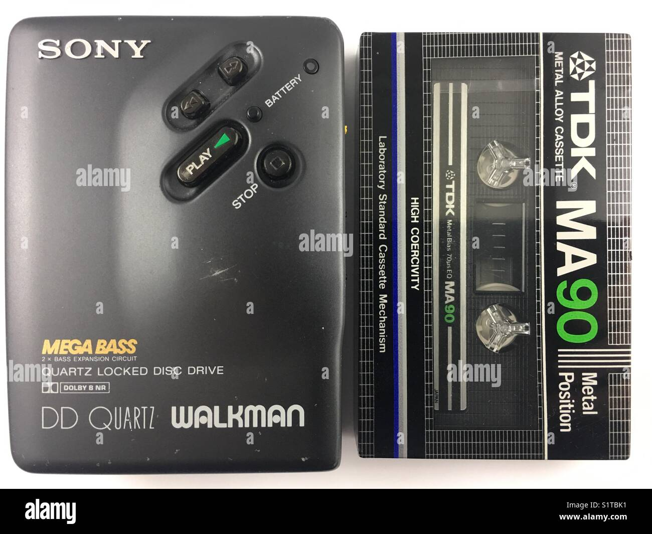 Sony cassette Walkman alongside a TDK metal cassette tape. - Stock Image