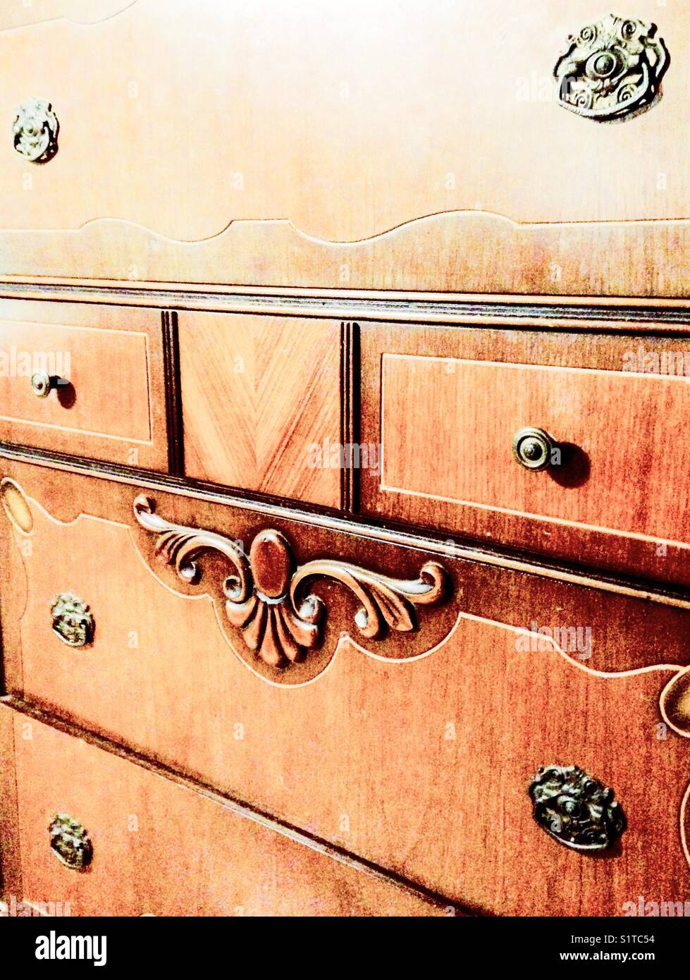 Front of a wooden bedroom chest of drawers - Stock Image