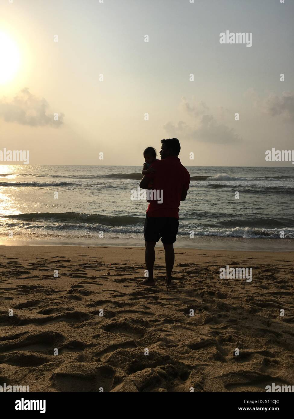 A father and son like sea and shore - Stock Image