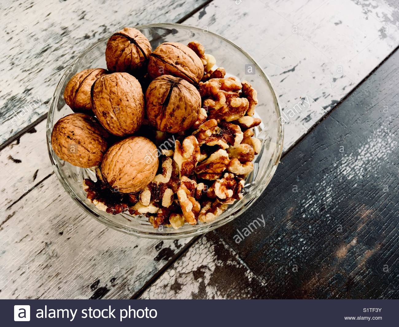 Walnuts presented in a glass bowl Stock Photo