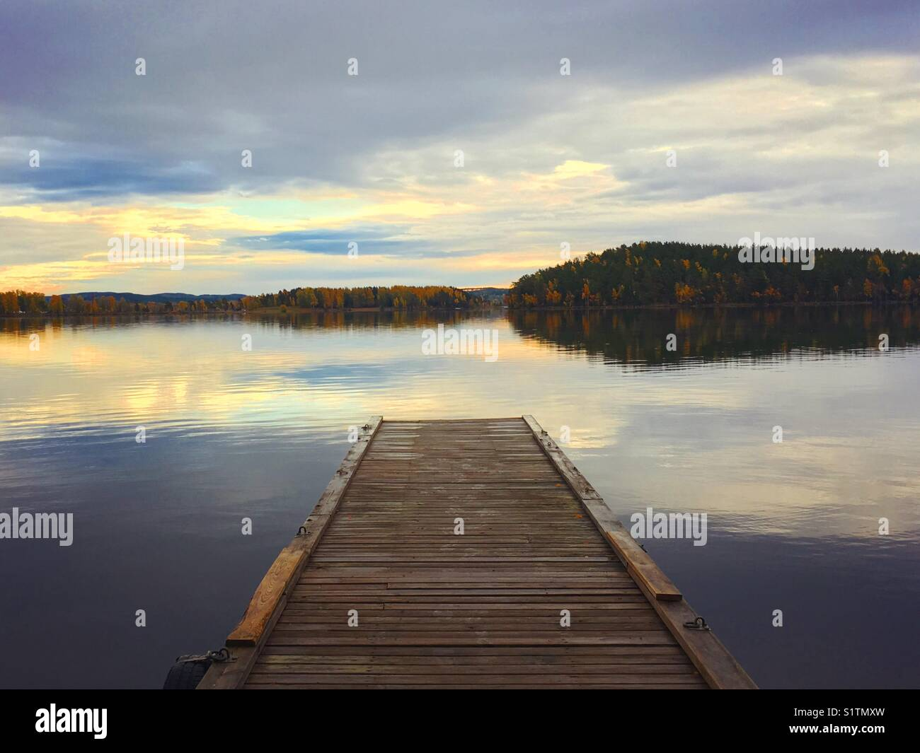 A beautiful sunset over a peaceful lake in Dalarna, Sweden. - Stock Image