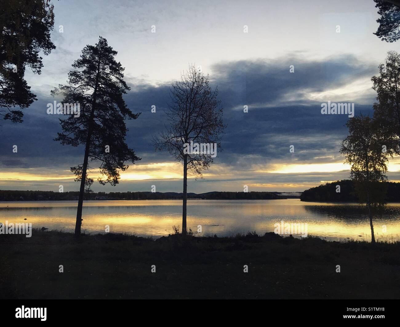 Sunrise over a lake in Dalarna, Sweden. - Stock Image