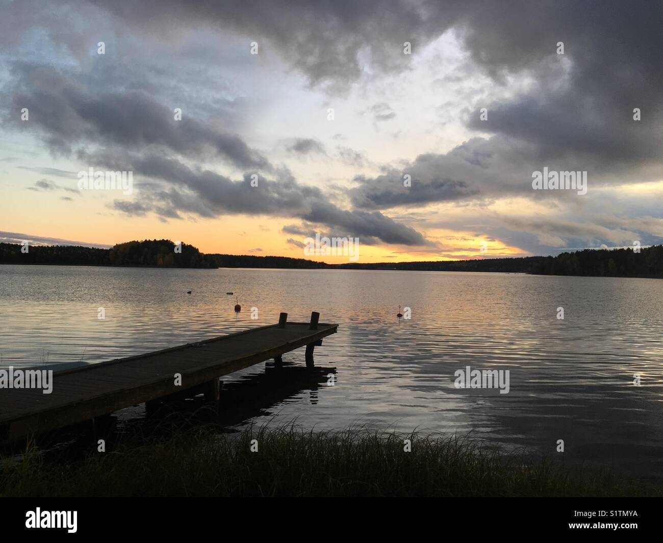 Sunset over a lake in Dalarna, Sweden. - Stock Image