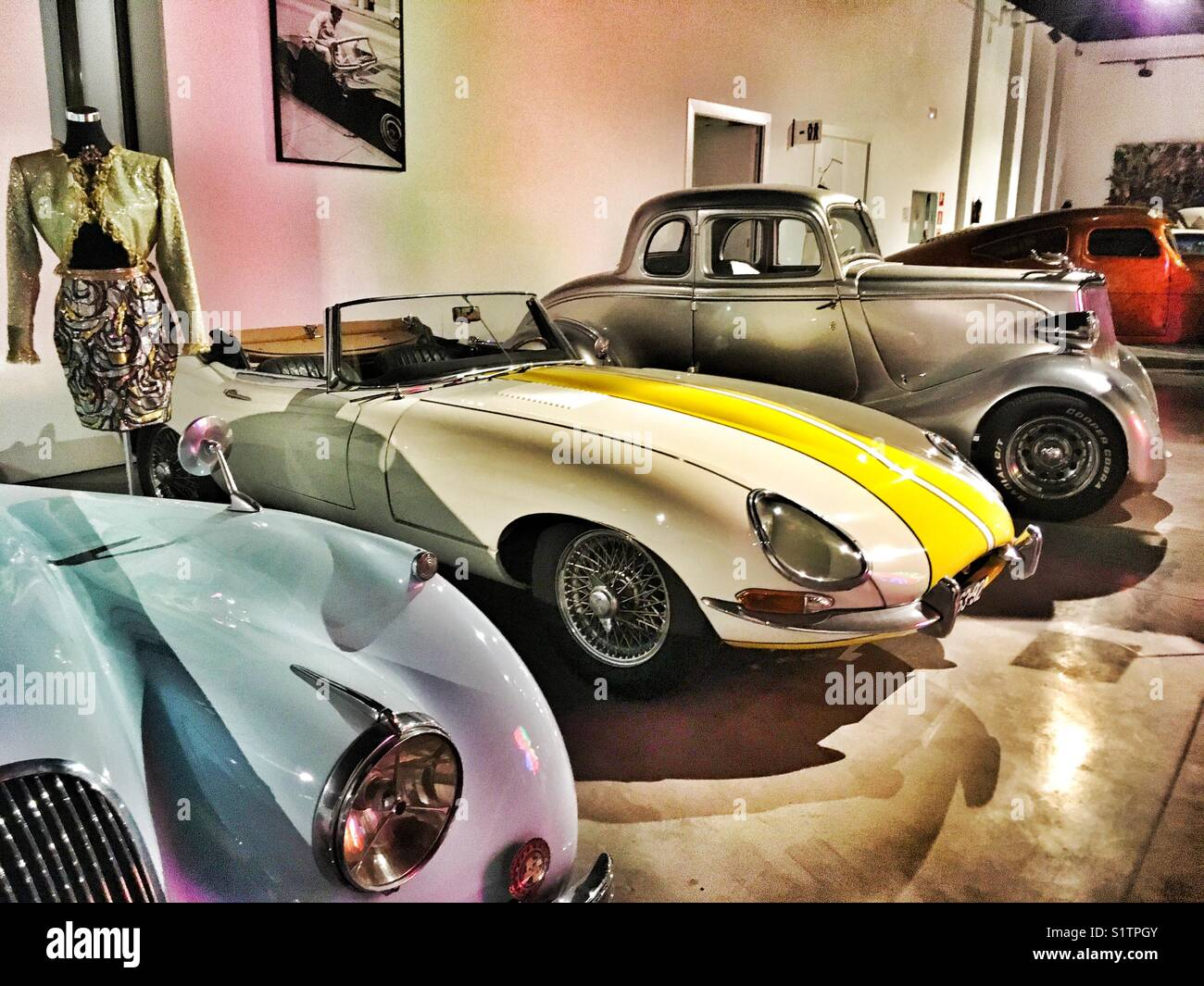 Automobile museum of Málaga, Andalusia, Spain. Jaguar 1952, Jaguar 1961, Ford 1934 model 40 - Stock Image