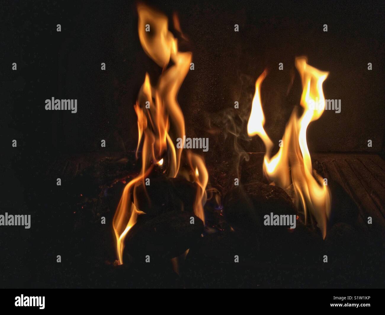 Dancing flames in an open fire place. - Stock Image