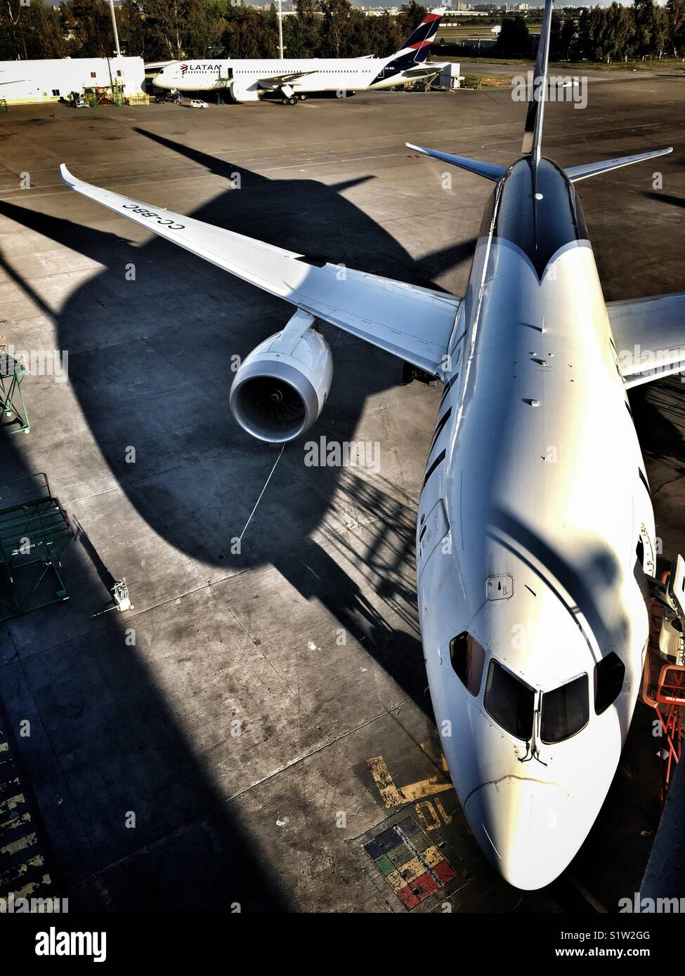 LATAM airport and its chubby shadow in the morning sun at Santiago de Chile airport - Stock Image
