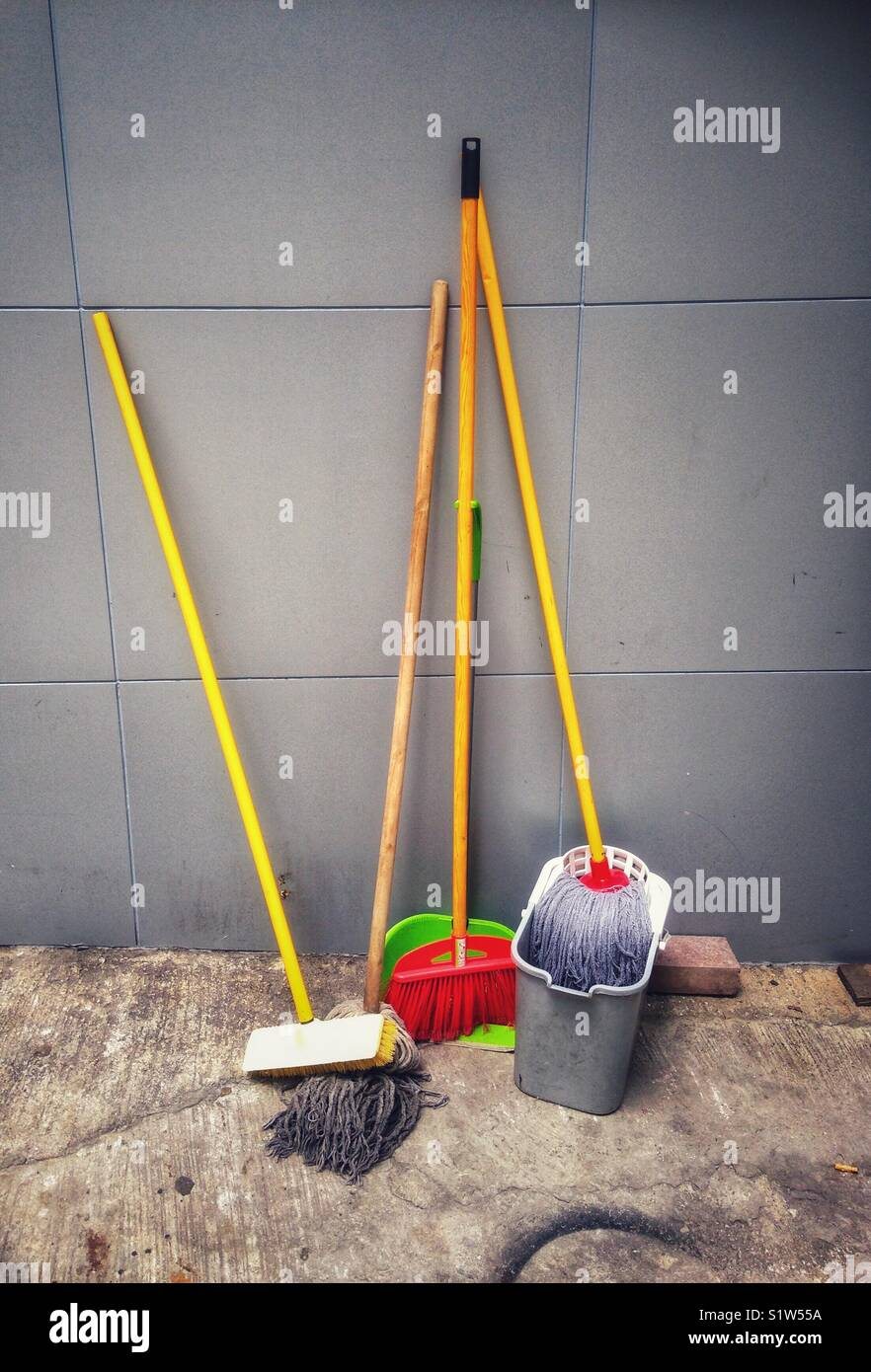 Mops brushes and a bucket - Stock Image