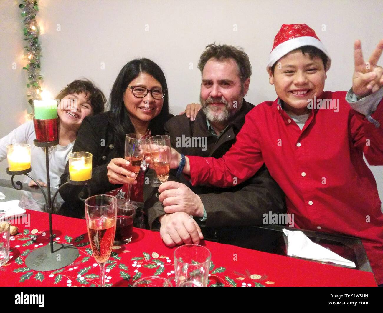 Interracial family celebrating Christmas. - Stock Image