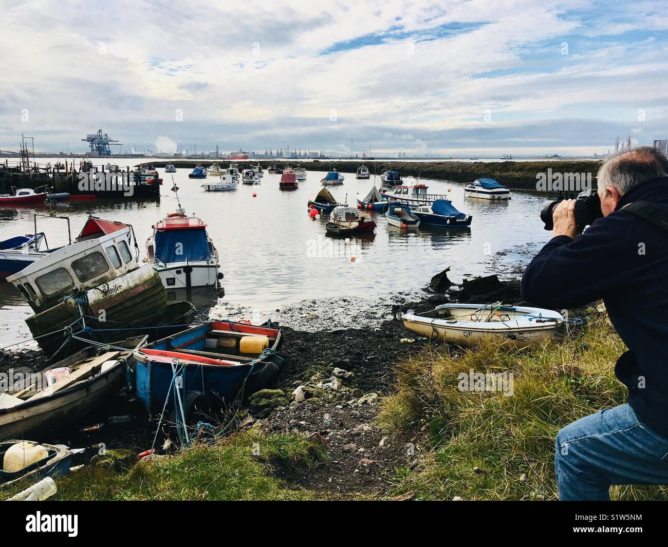 A man taking photograph's at Paddy's Hole in Redcar, Teesside. - Stock Image