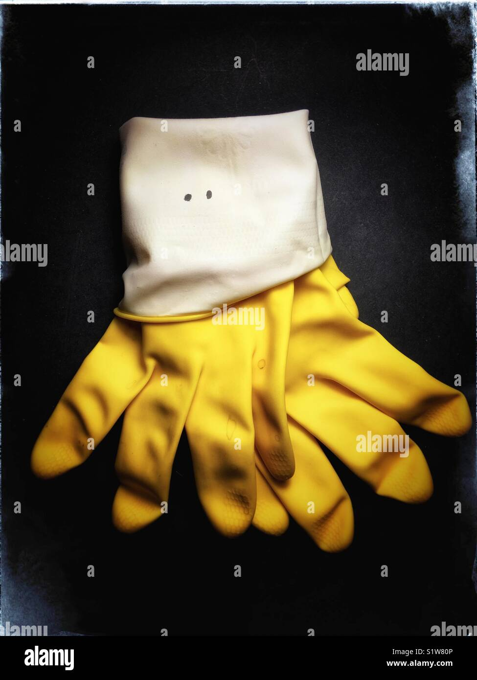 Yellow rubber washing up gloves octopus - Stock Image