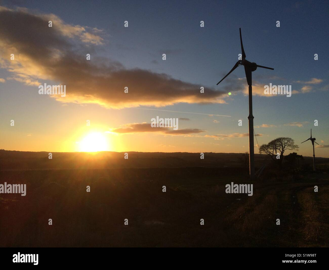 Sunset and turbines - Stock Image