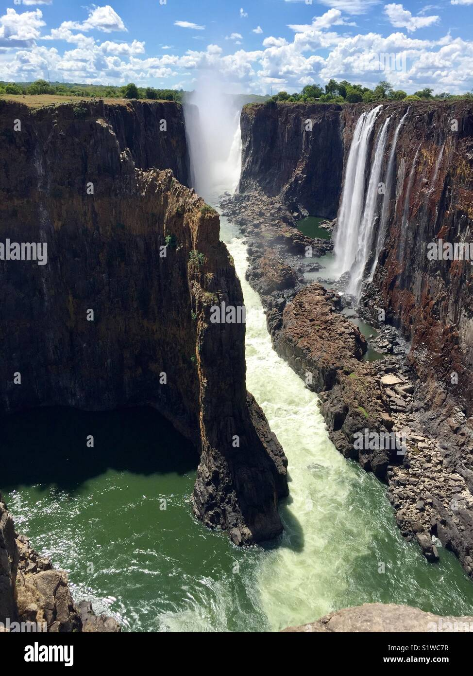 The Bare face of the Mighty Victoria Falls in October. - Stock Image