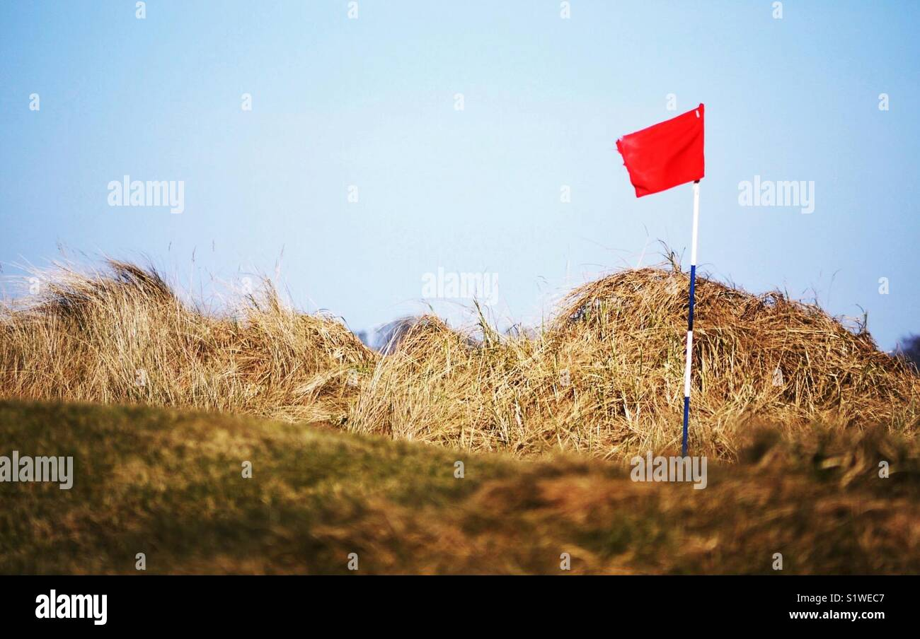 Red flag on Carnoustie Golf Course, Angus, Scotland Stock Photo