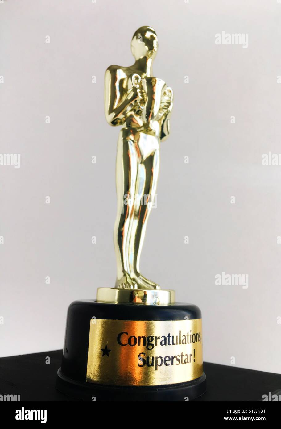 """A trophy that reads """"congratulations superstar"""". - Stock Image"""