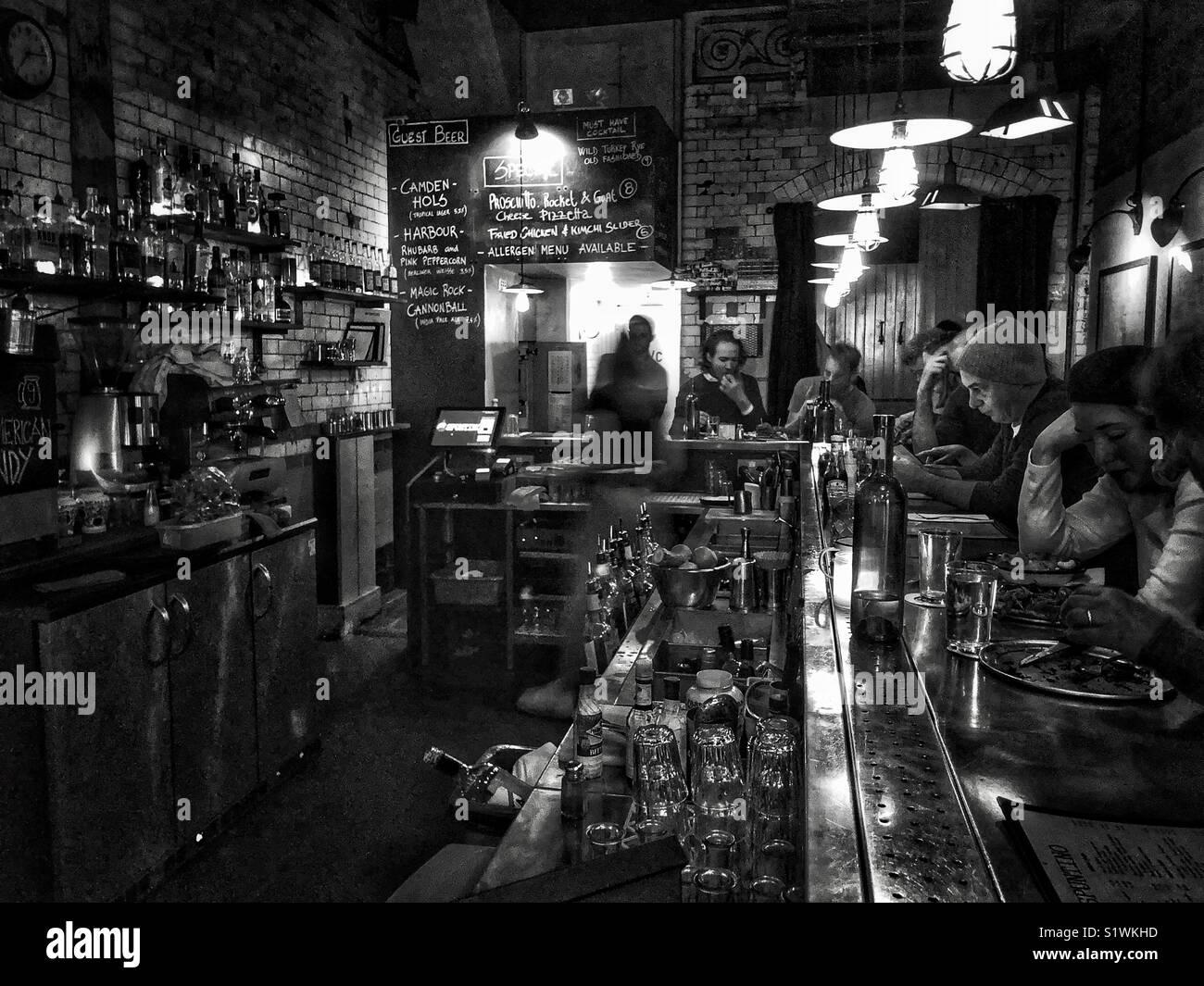 Diners at Spuntino bar and restaurant, London. - Stock Image