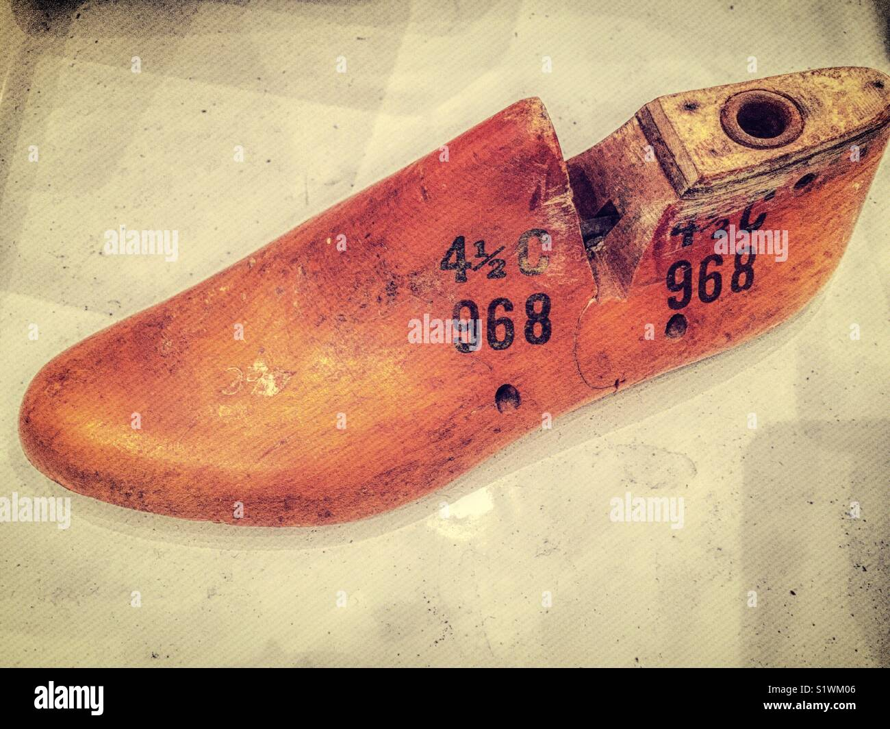 Vintage wooden shoe last for a  woman's left foot, United States. - Stock Image