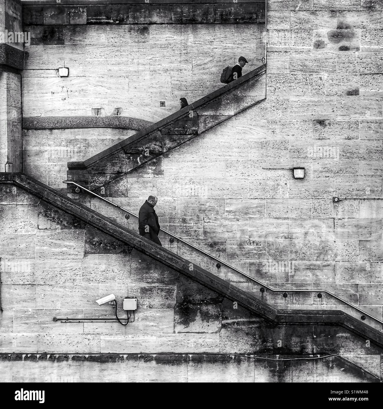 People walking up and down the steps at the British Film Institute on the South Bank, London. - Stock Image