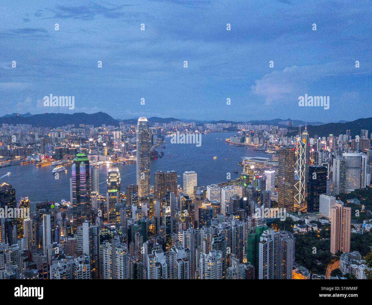 Hong Kong Victoria Harbour view from the Peak at evening - Stock Image