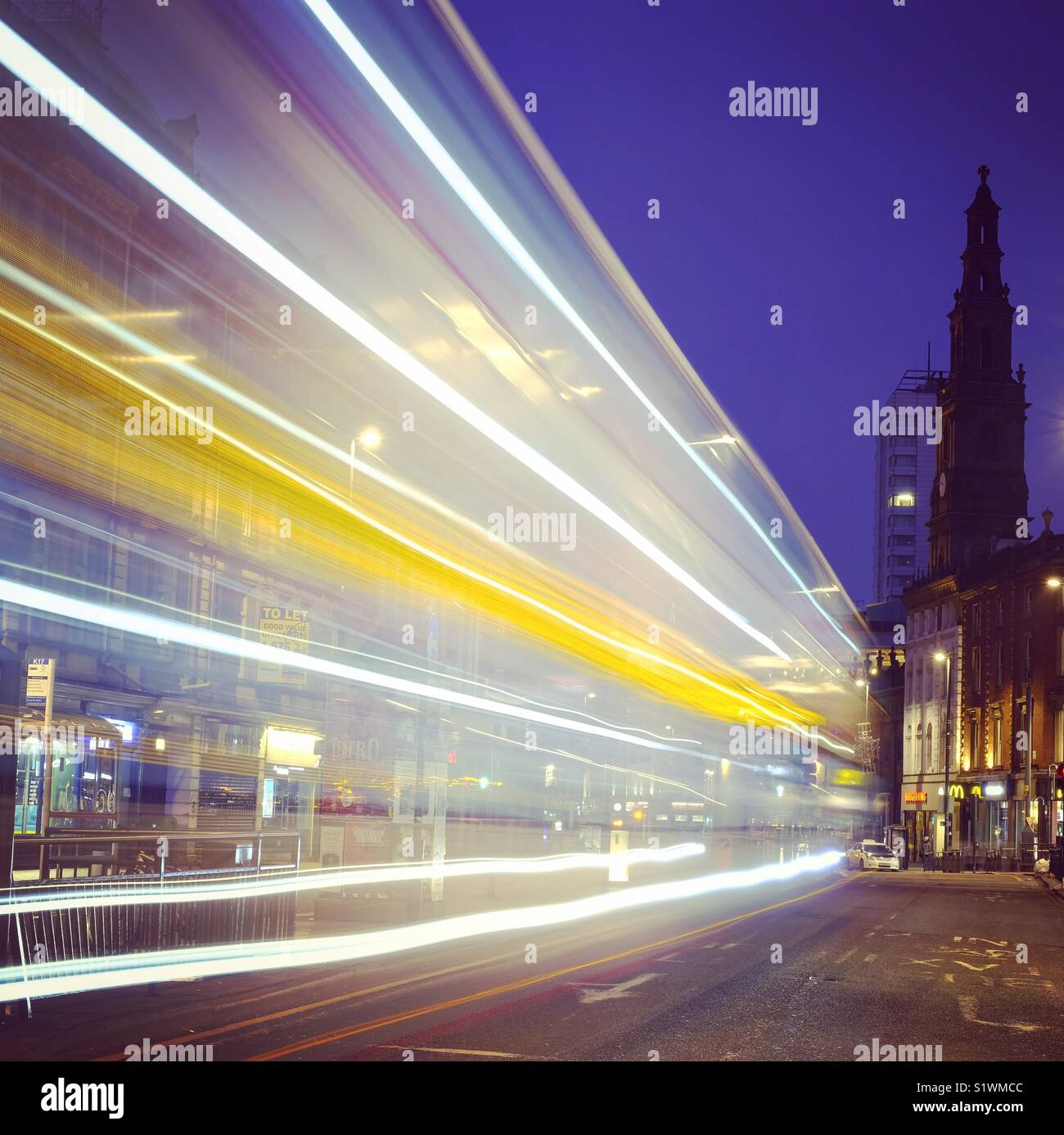Light trails in Leeds City Centre, West Yorkshire, England. - Stock Image