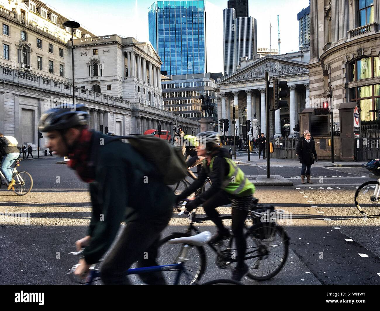 Cyclists at Cornhill and Bank Junction in the City of London, England on January 16 2018 - Stock Image