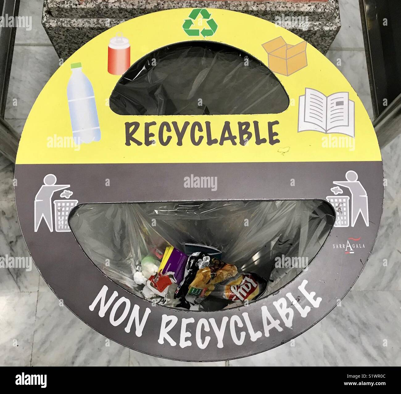 Bin with sections for recyclable and non- recyclable waste - Stock Image
