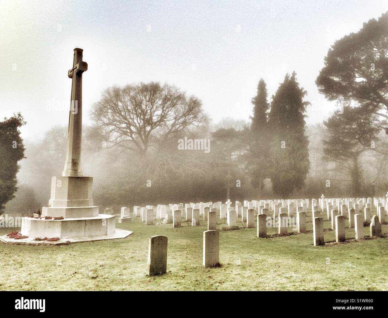 Military Cemetery on a misty winter morning, Royal Victoria County Park, Netley, Hampshire, England, UK Stock Photo