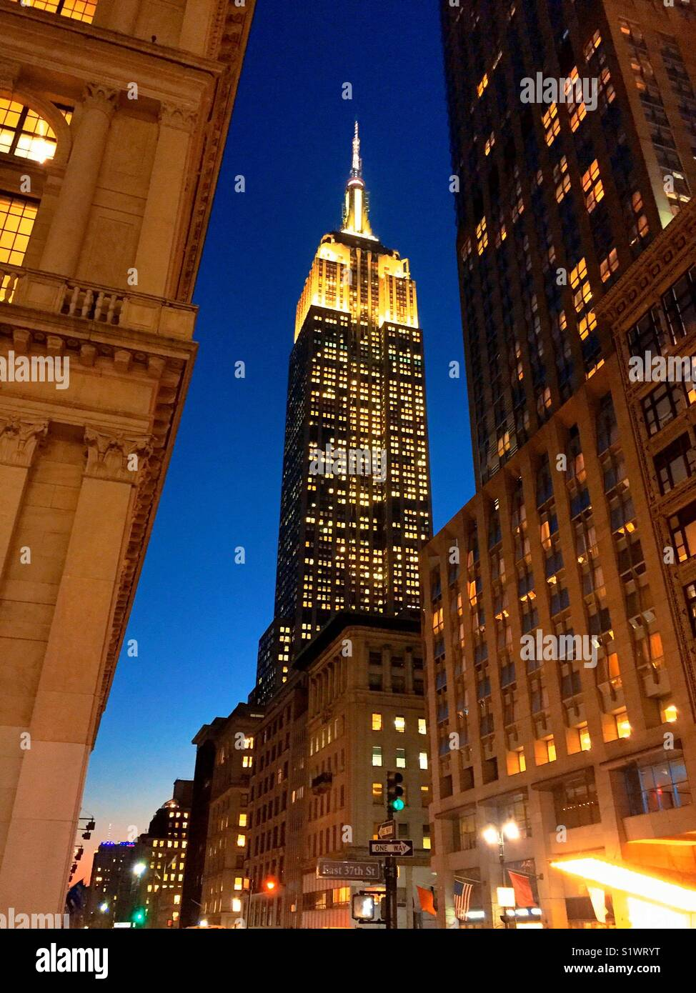 View of the Empire State building from Fifth Avenue at dusk, New York City, USA - Stock Image