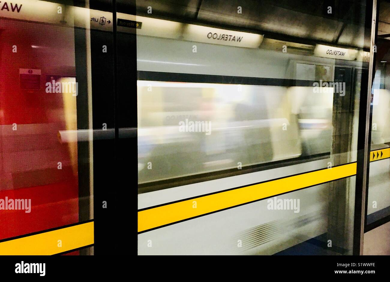 Tube arriving at Waterloo Station. - Stock Image