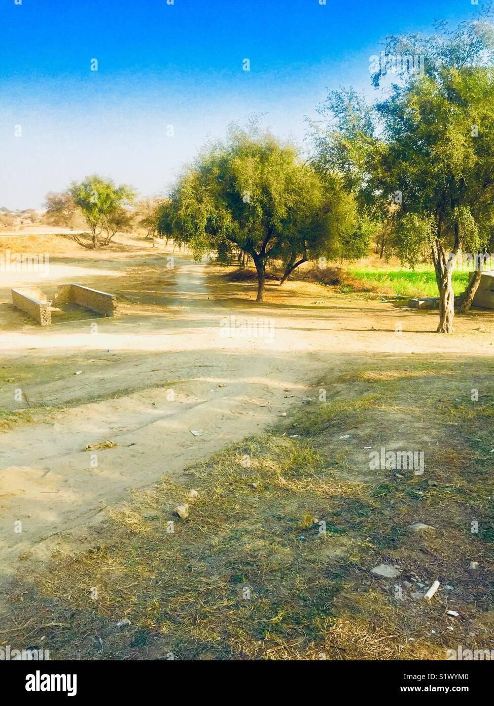 Unpaved way view in village of beautiful Pakistan - Stock Image