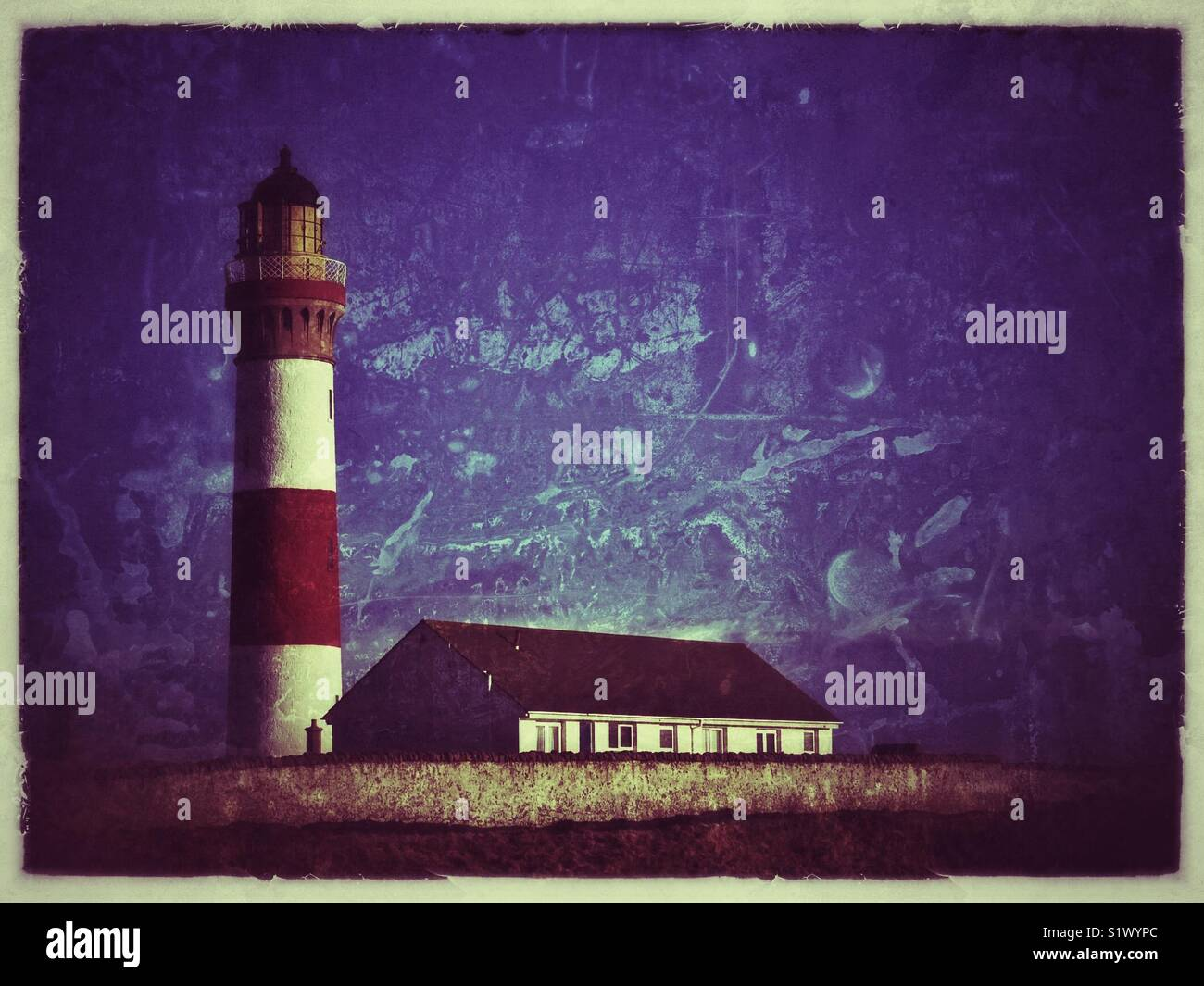 Lighthouse with building adjacent. Stock Photo