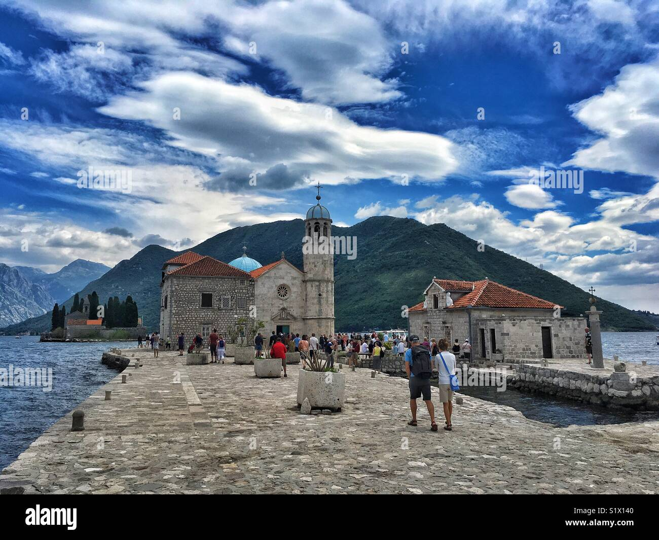 Tourists on a Our Lady of Rocks islet in Bay of Kotor, Montenegro Stock Photo
