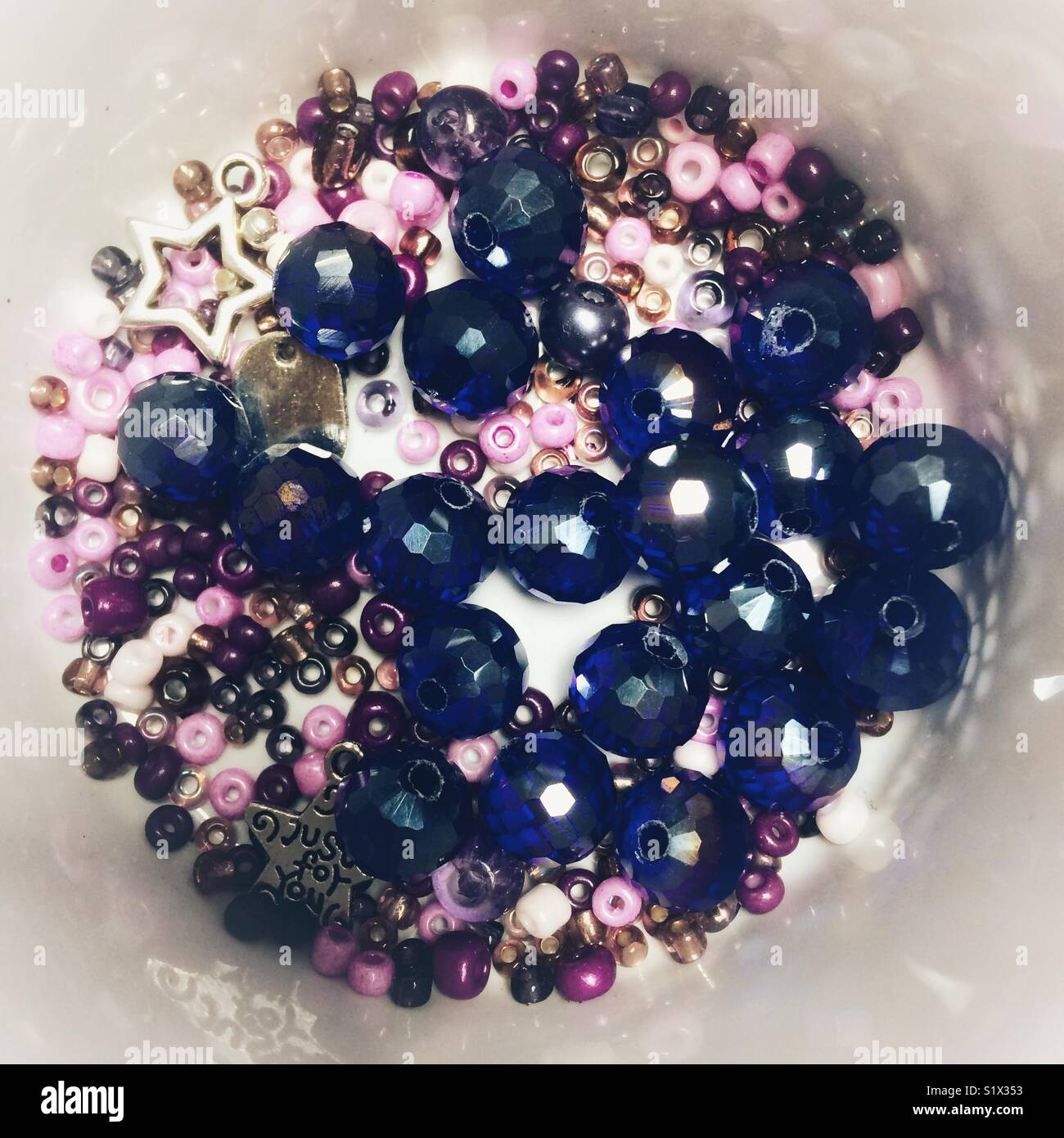 Variety of colourful beads for jewellery making and crafting. - Stock Image