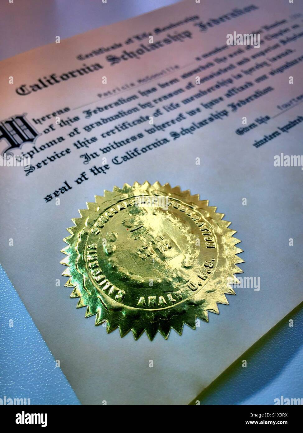 Gold embossed seal on California scholarship Federation certificate, United States. - Stock Image