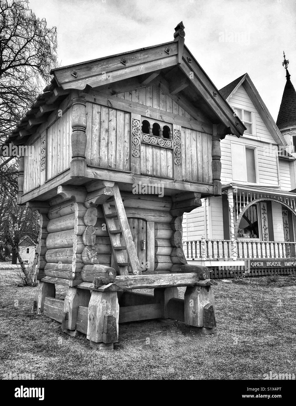 Traditional Scandinavian stabbur next to Victorian Home, Mount Horeb