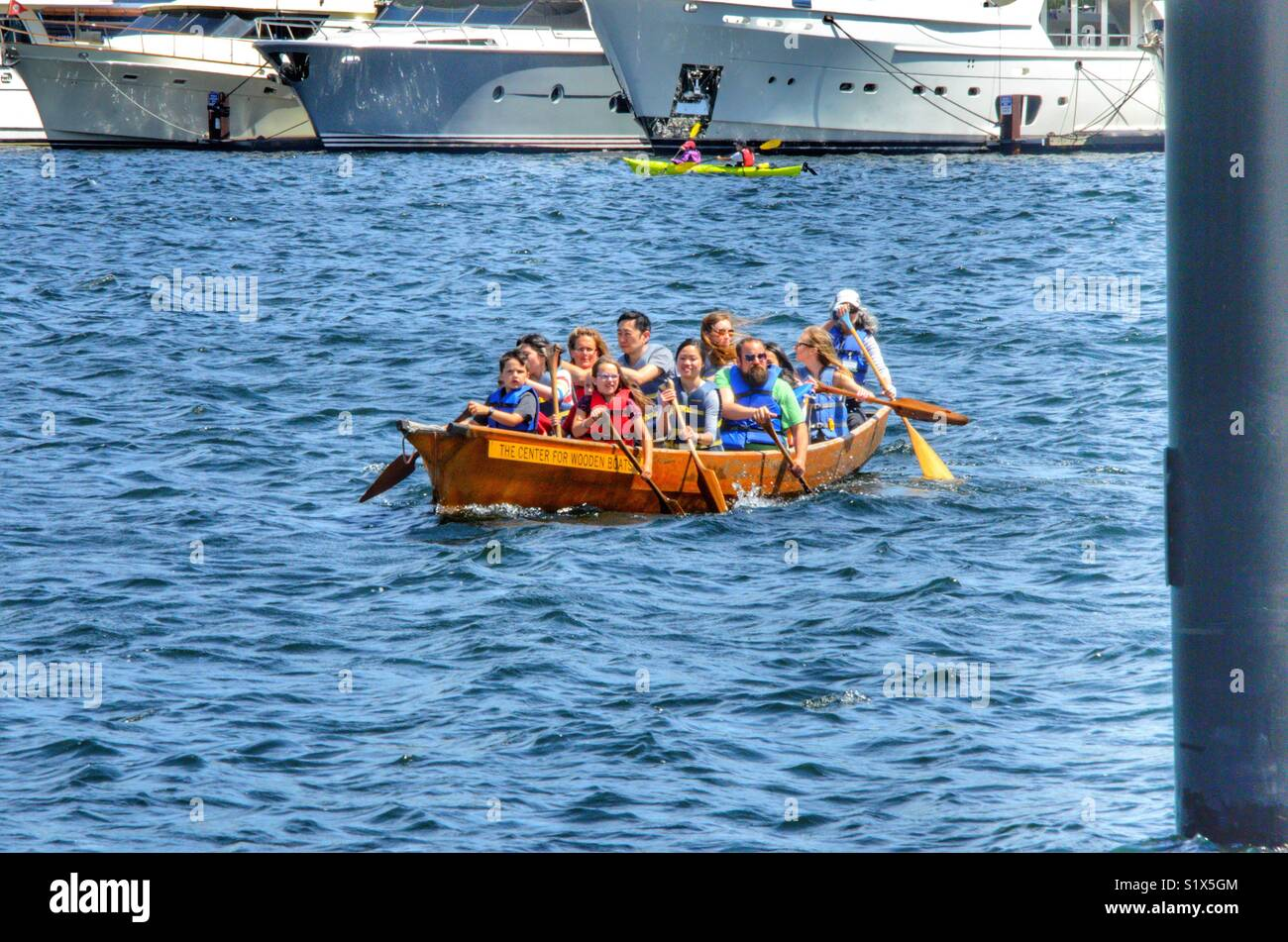 People out paddling in a large boat on Lake Union in Seattle Washington - Stock Image