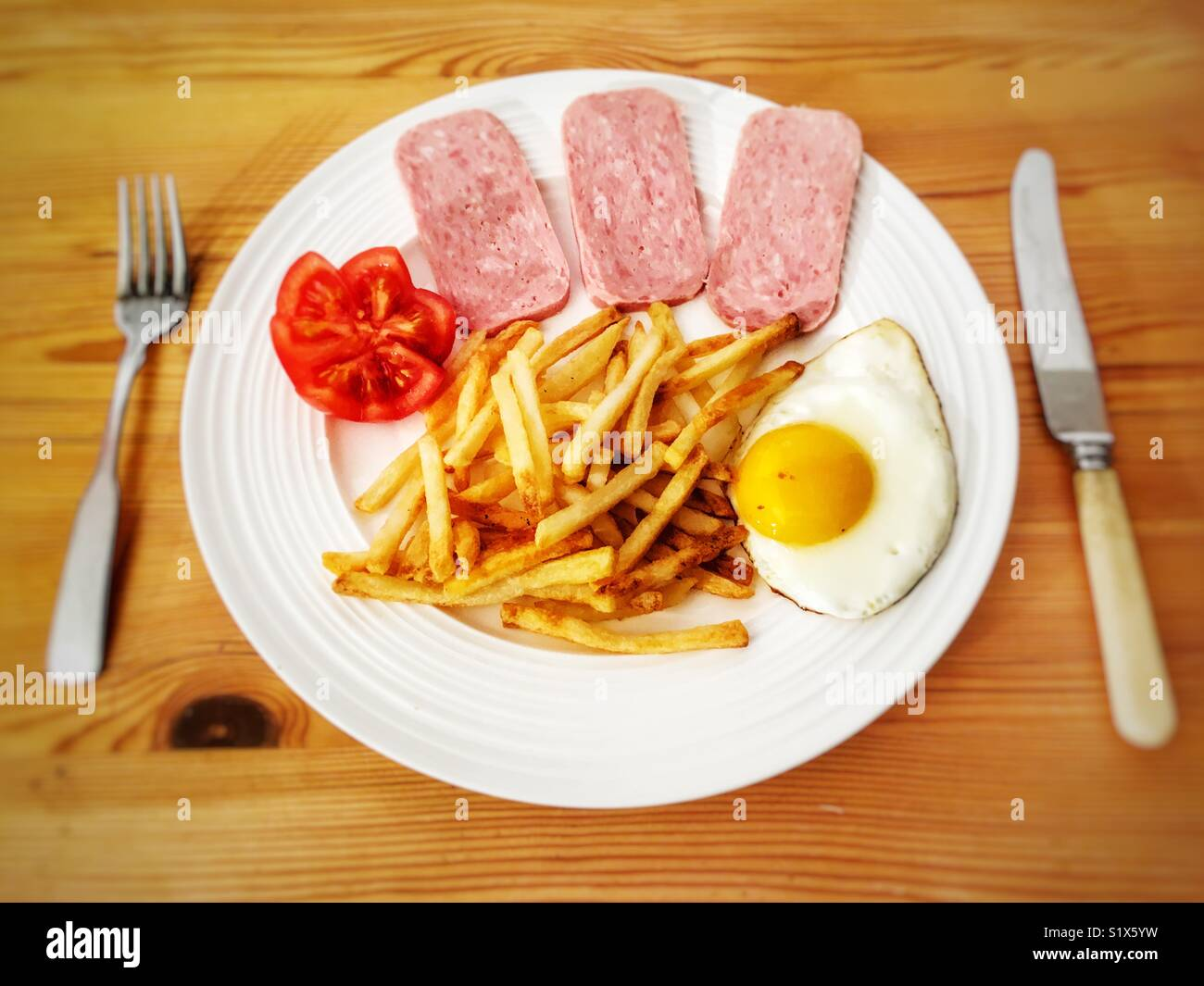 Spam chips and egg with tomato - Stock Image