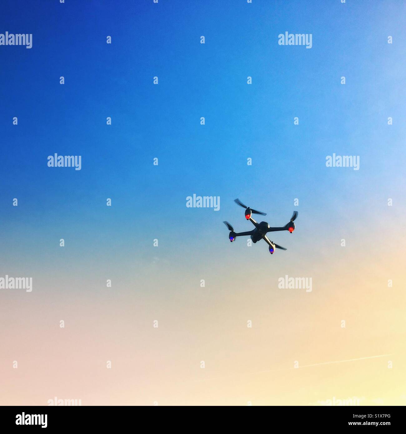 A flying drone in the sky - Stock Image