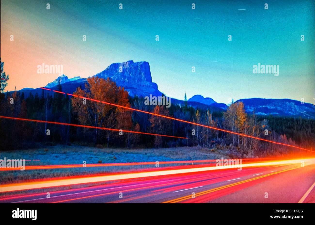 Mountains and tail lights - Stock Image