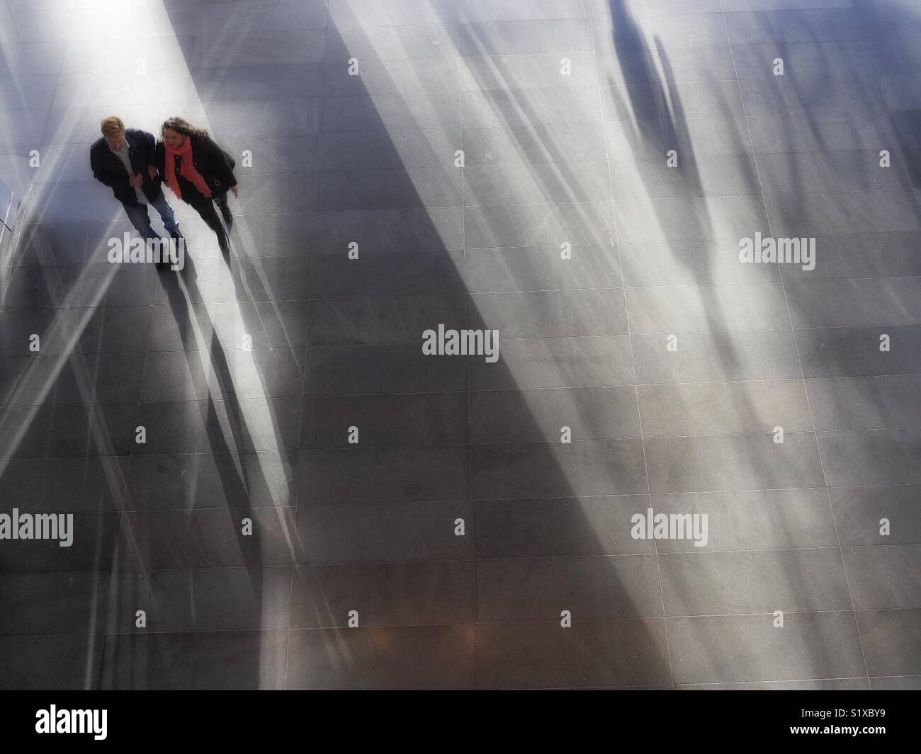 Couple walking through Mall, New York City, USA Stock Photo