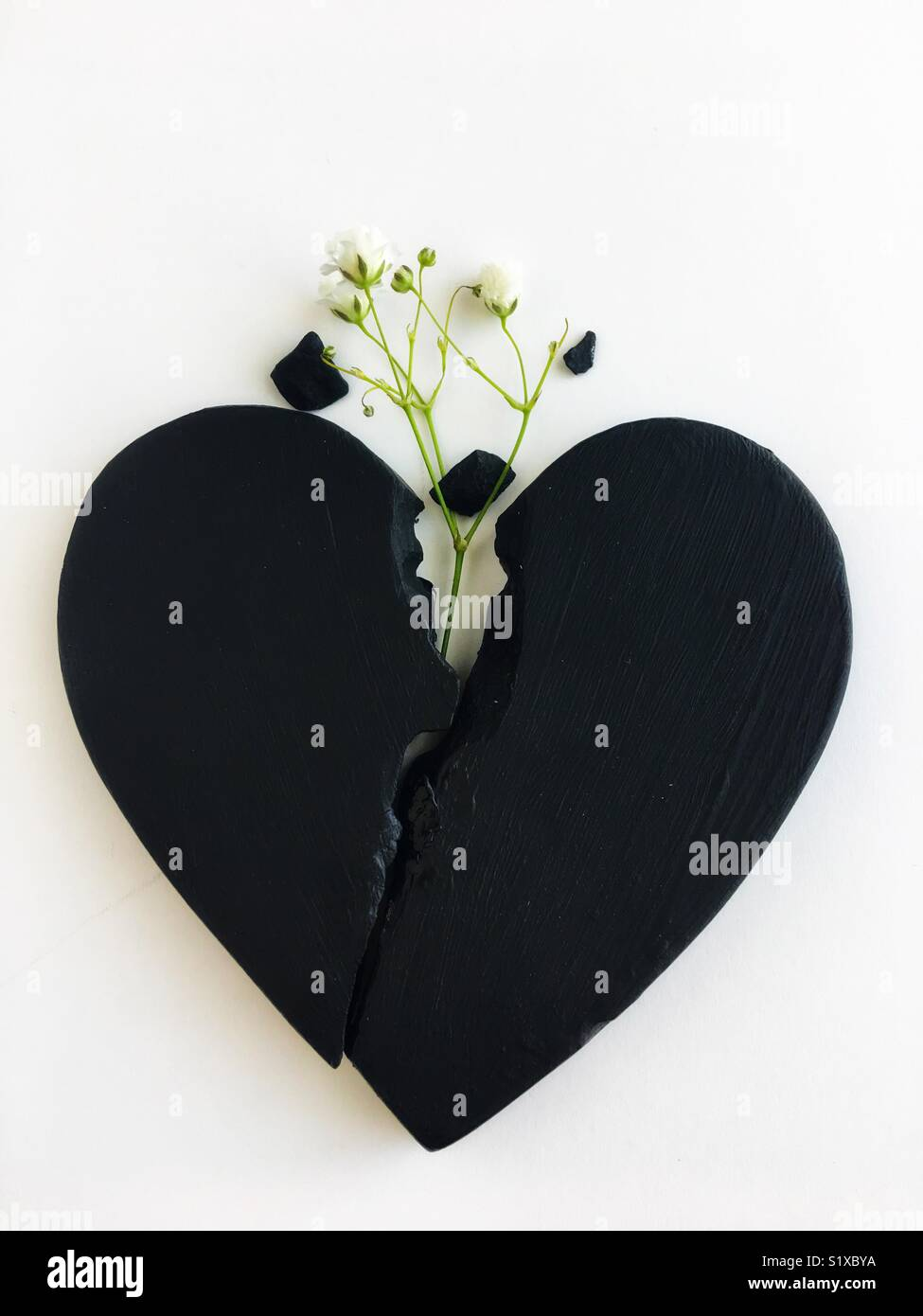 Conceptual: a broken heart healing. - Stock Image